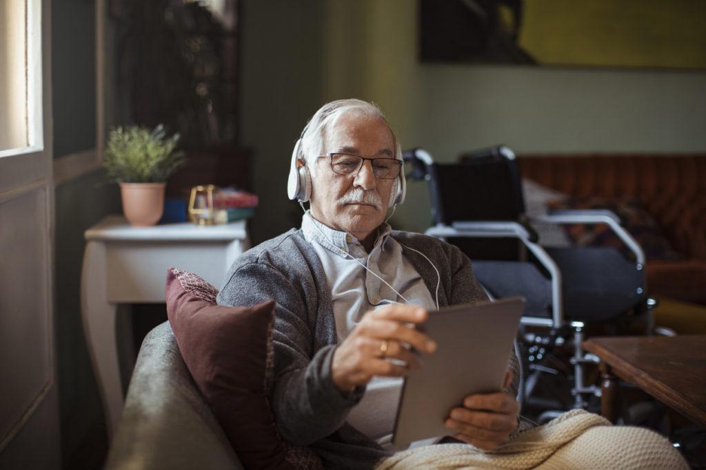 Image: Senior Man using a Tablet at Home