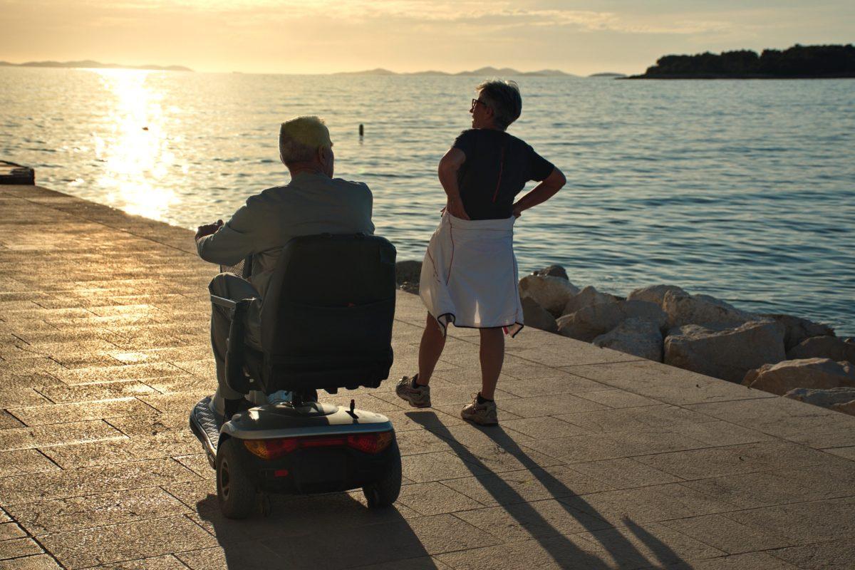 Image: Senior couple walking a waterfront
